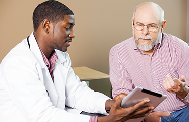 Doctor talking to patient about different treatment options