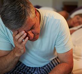 Man experiencing insomnia