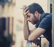 Man smoking depressed