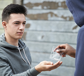 Young person buying ecstasy