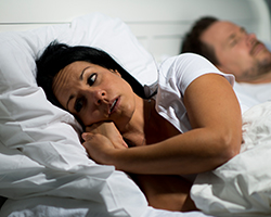 Woman experiencing insomnia