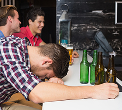 man passed out from drinking too much