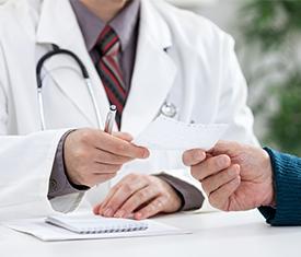 doctor-signing-prescription-creating-habit-for-patient